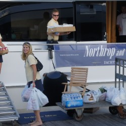 Superyacht crew bringing provisions onboard after a shopping trip.