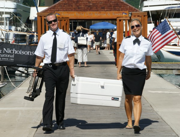Yacht Crew walking up dock - Photo Credit: Suki Finnerty of YachtingToday.TV.