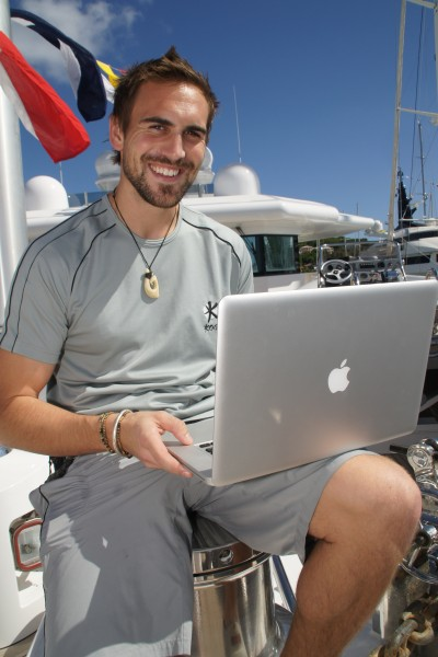 Megayacht Crewmember on his computer - Internet Job Hunt