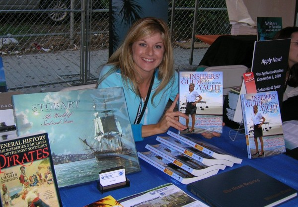 "Julie Perry at Miami Book Fair International 2006, promoting the 1st Edition of ""The Insiders Guide to Becoming a Yacht Stewardess"" at the Bluewater Books & Charts booth."