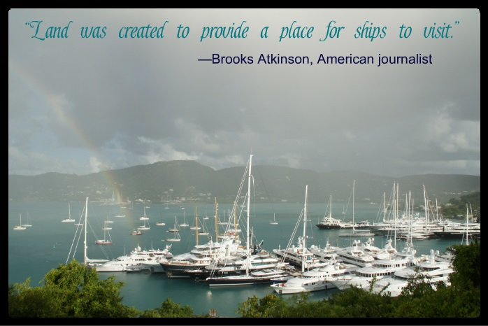 """Land was created to provide a place for ships to visit."" -Brooks Atkinson, American journalist - Superyachts in a marina with a rainbow -  www.WorkOnAYacht.com"