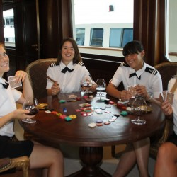 "Stewardesses on M/Y ""Big Aron"" taking a break onboard. Photo by Suki Finnerty of YachtingToday.TV"
