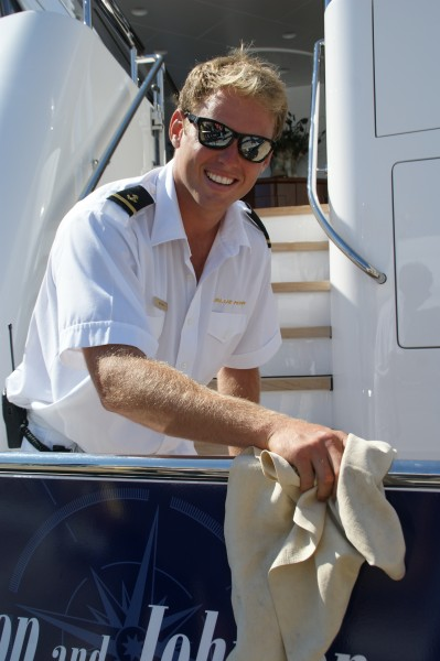 Megayacht Deckhand Polishes the Rails