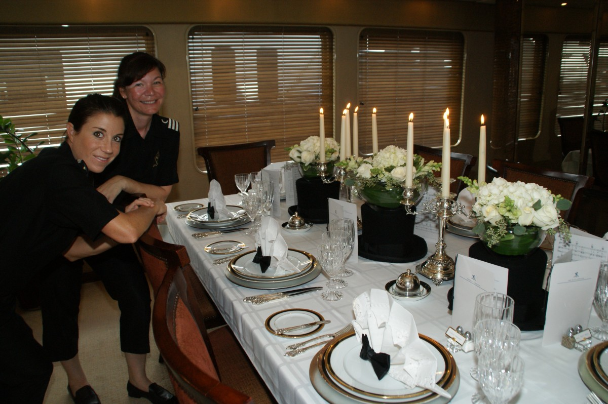 "From the 2nd Annual Perfect Setting Tabletop Challenge, presented by Presented by Yacht Next at the 2009 Fort Lauderdale International Boat Show.  3rd Place Winners in the ""Putting on the Ritz"" category, Gina Loesby and Sarah Harvey, of M/Y ""Zelda."""
