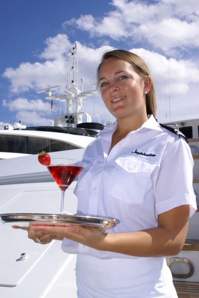 Yacht Stewardess Serves Drink
