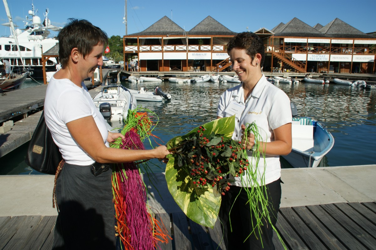 A chief yacht stewardess pays for a floral display delivery.